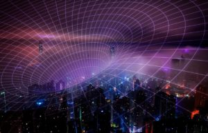 a modern city scape at night from the air, with network lines superimposed on top.